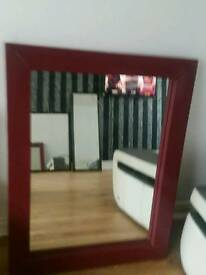 Large red leather mirrors
