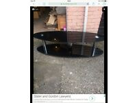 Large oval glass tv stand
