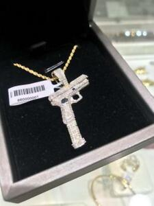 10k YELLOW GOLD AND 0.72CT DIAMONDS GUN PENDANT