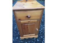 Tall solid pine bedside cabinet