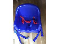 Child's booster seat with eating tray