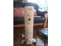 Electric oil radiator with thermostat etc