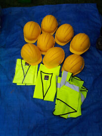 Hard hats and fluoresent bibs