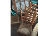 4 pine and wicker chairs