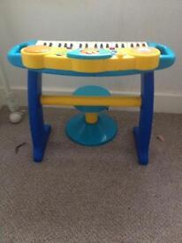 Keyboard and stool.