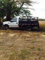 1999 f350 one ton boom truck with Plow