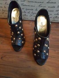 Black open toe studded heels