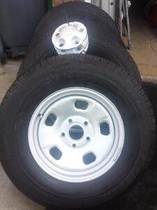BRAND NEW TAKE OFF 2016 DODGE RAM 17 INCH WHEELS  WITH GOODYEAR WRANGLER 265 / 70 / 17 ALL SEASON  TIRES.