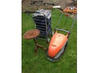 Lawn mower, Table, Black leather sofas with some other items