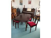 Mahogany extending dining table and four chairs.