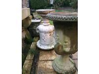 Pair of cast stone urns