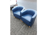 2 blue leather look bucket chairs with wood legs