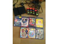 PlayStation 2 with Buzz controllers and 7 games