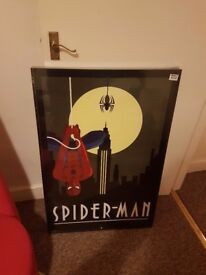 Large print of Spiderman would go well in mancave still in wrapping very smart