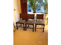 Three matching solid wood dining chairs