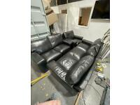Black leather couches and chair
