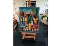 Small Jamaican Painting on easel