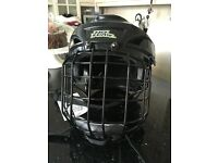 Ice hockey or roller hockey helmet