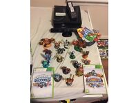Xbox 360 with Kinect and skylanders + 20 games plus wifit console