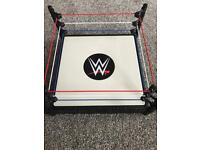 WWE ring and 5 wrestlers