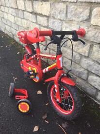 """Red fireman themed children's bike, 12"""" wheels"""