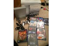 Boxed silver Sony ps2 console and games