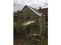 glass and aluminium greenhouse with potting table