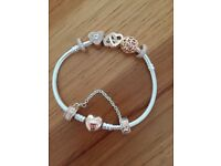 Rose gold and silver pandora bracelet and charms