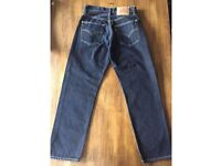 LEVI'S 521 30 WAIST 30 LEG. DARK WASH. NEW WITHOUT TAGS.