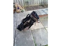 2 golf bags and bits