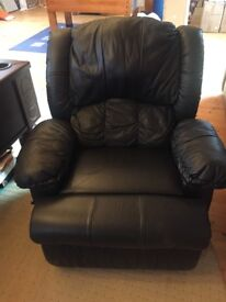 Black leather recliner with cup holders