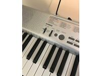 Casio Keyboard with stand. Very good condition. Model LK-130. Great for beginners!
