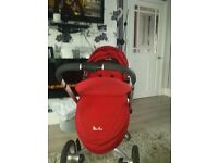 Silvercross surf buggy comes with rain cover and storage baskets .also has footmuff and saftey bar .
