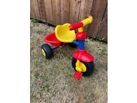 Small child's multicoloured trike