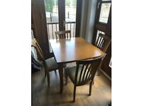 4-6 seater extending dining table and chairs