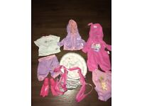 Bundle of baby born clothes and carrier