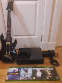 Xbox One with 4 games plus Guitar Hero guitar and one controller