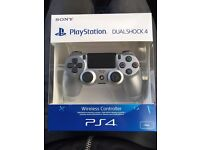 PS4 Controller Silver New and Sealed