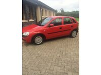 Red vauxhall Corsa for sale