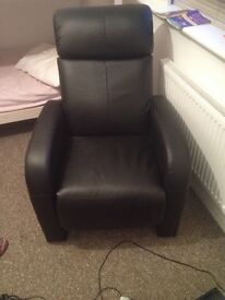 Black leather massage/games chair