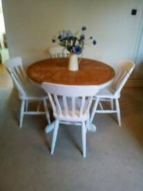 Shabby chic dinning table and four chairs.