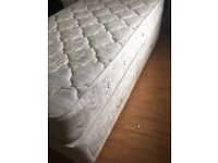 Single divan bed with mattress and attachable head board.