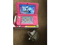 Pink 3DS XL with charge cable