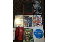 Nintendo Wii Mini In Red + games and controllers