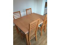 Beech wood extending dining table and 4 chairs