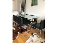 Glass dining table and 6 leather Italian designer chairs