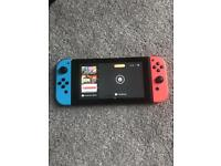 Nintendo Switch Console - 4 Games & 2 Controllers