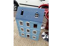 Wooden dolls house. Blue
