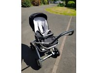 Nuna Ivvi travel system including travel cot, buggy seat, rain covers, and foot muff