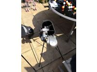 Various Golf clubs and 2 bags